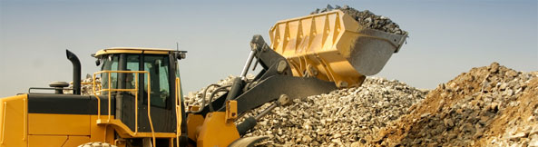 Loader Tipping Rocks in a Quarry