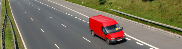 Red Ford Transit Van on Motorway